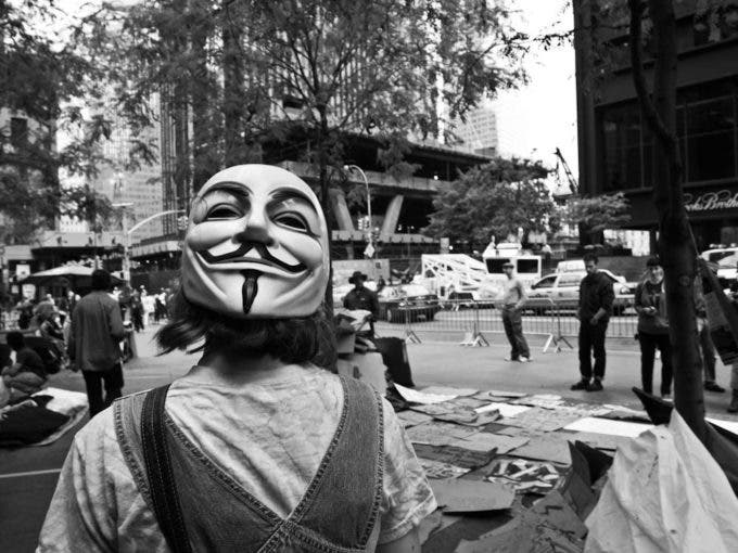 One of the members of Anonymous wears her mask backwards during preparation