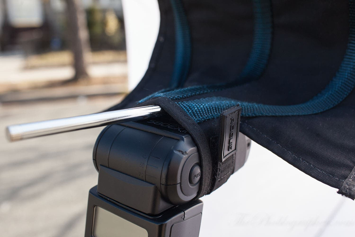 Useful Photography Tip #11: Use Belts to Fit a Shoot Through Umbrella To a Flash
