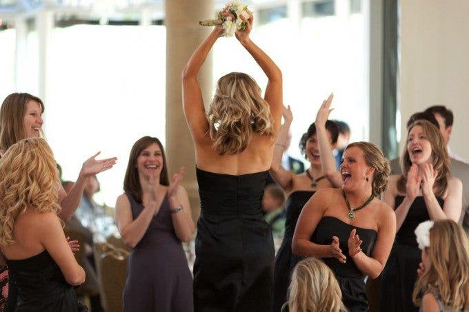 girls celebrate after a bouquet catch