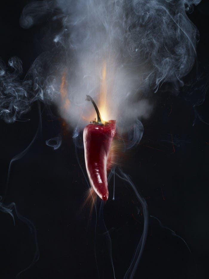 Adam Voorhes Blows Up a Serrano Pepper; Photographs It Using a Sound Sensitive Trigger