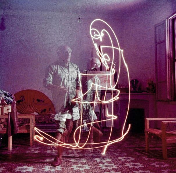 Triple exposure of artist Pablo Picasso drawing with light at his home in Vallauris