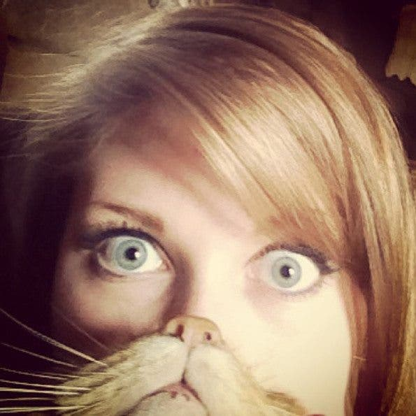 Cat Bearding Is the Newest Photo Meme Involving The Internet's Cuddliest Critter