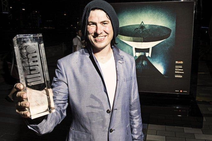 Lorenz Holder, Red Bull Illume 2013 Overall Winner, with winning photograph in background