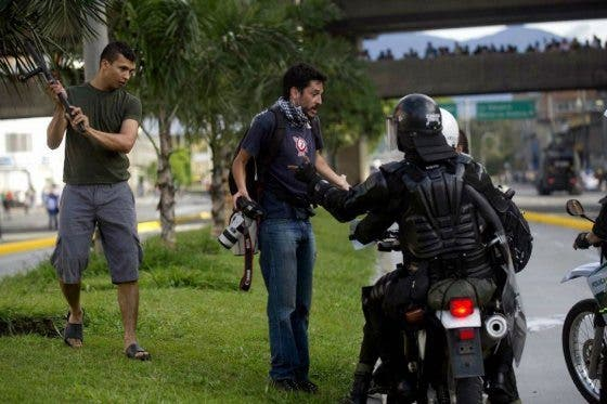 Photographer Gets Punched in the Face by Police Officer at Colombia Protest