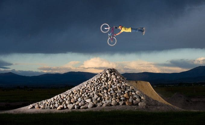 Man freestyle mountain biking jumping on track in Minden, Nevada.