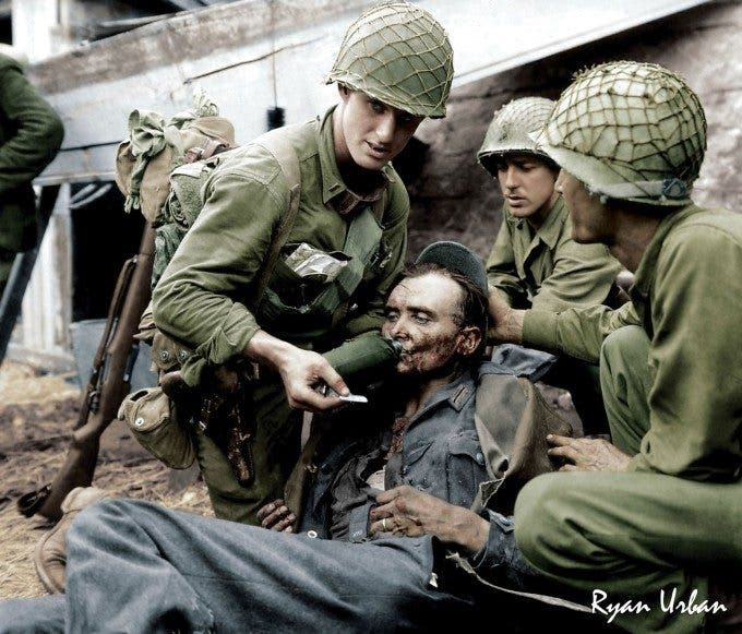 Allied Soldiers Giving Water to Wounded German, WWII - Imgur