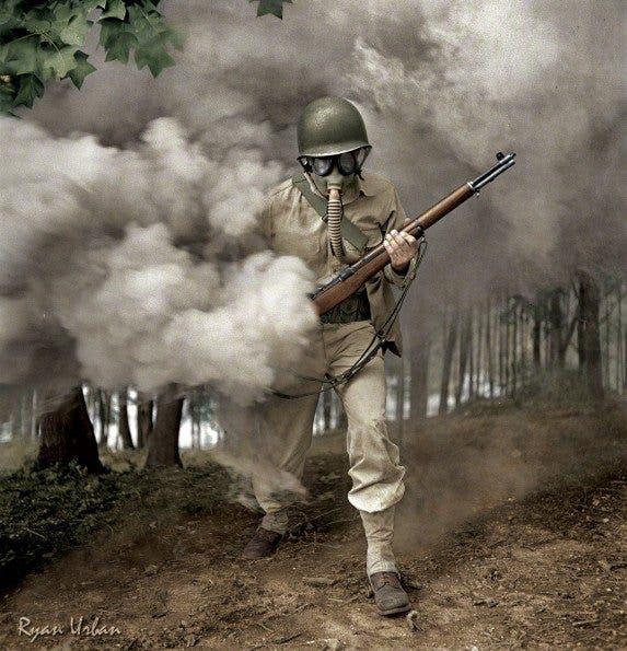 Sergeant George Camblair Practicing With His Gas Mask In A Smokescreen. Fort Belvoir, Virginia, 1942 - Imgur