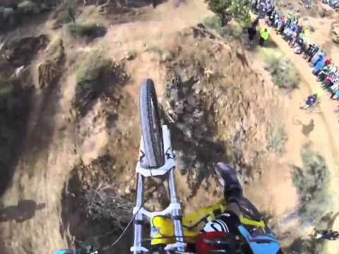 Watch These Mountain Bikers Barrel Down a Rocky Track on a Narrow Ridge