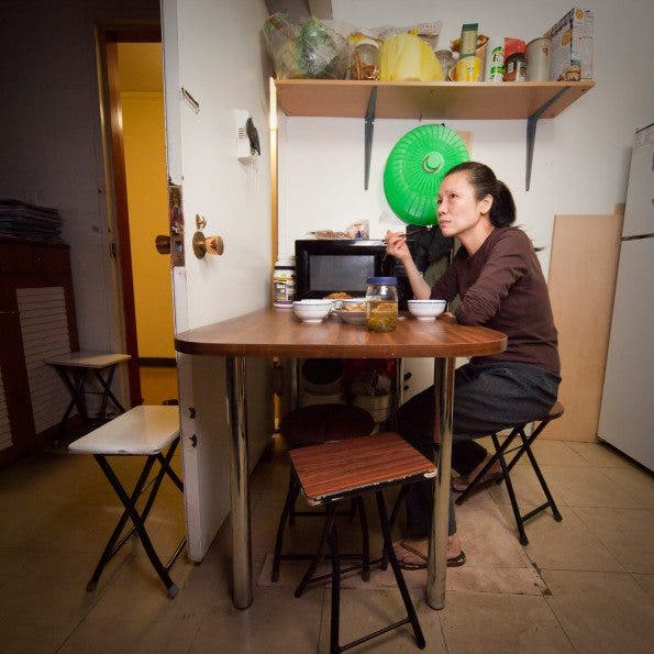 Zheng Yun lives with her daughter and son, but usually eats dinner alone while watching TV. Age: 52 Time: 8:54 PM  Location: Vinegar Hill, Brooklyn