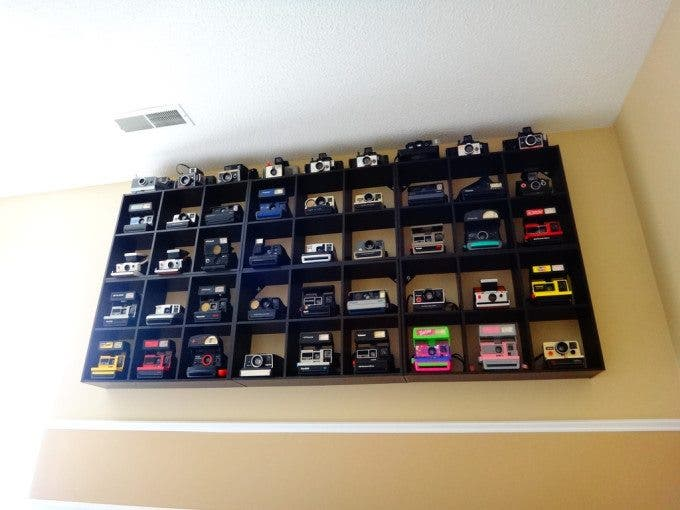 Polaroid collection on a shelf