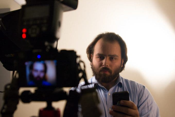 There I am controlling the LX100 remotely via the Panasonic Image App on my iPhone. Photo by Jake Becker.