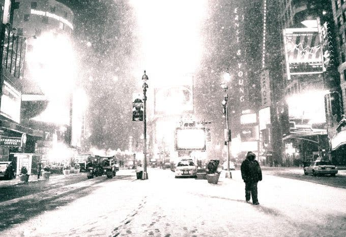new york city - night in times square as snow falls