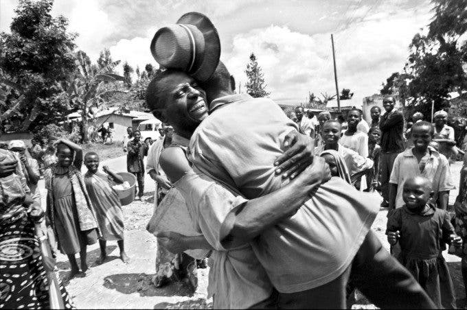 A Rwanda father and son reunite in their village after years of not know what had happened to each other when then were separated in the chaos of trying to flee the country's brutal genocide some two years earlier. ©Thomas James Hurst 1996