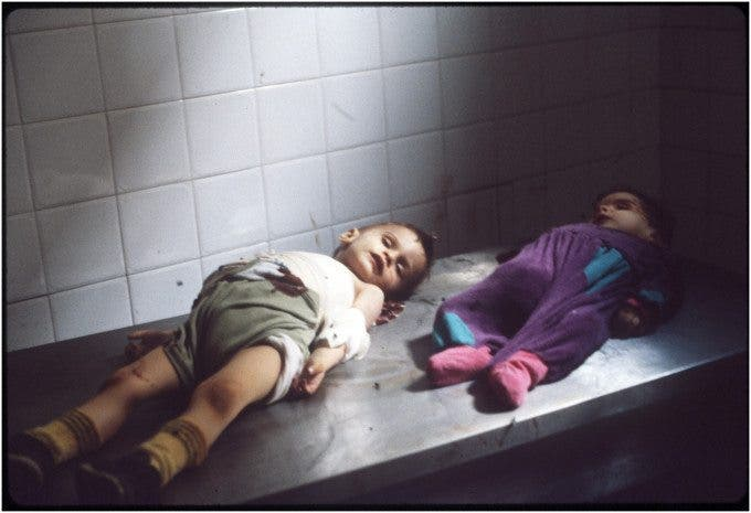 The first picture I ever took with a 35mm camera of two orphans killed by a sniper in Sarajevo the summer of 1992 ©Thomas James Hurst - 1992