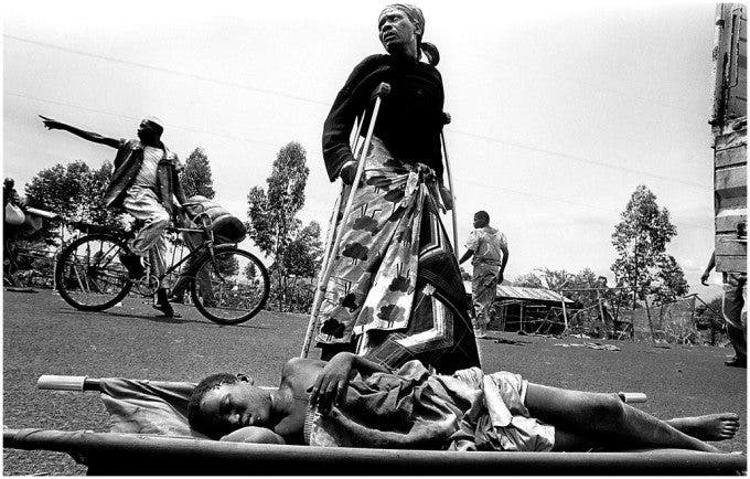 Rwanda - A man lays on a stretcher waiting to be rescued and taken to a hospital. ©Thomas James Hurst - 1996