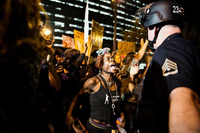Protesters confront police officers outside the Los Angeles Police Department headquarters office, in a second day of protests to the Grand Jury's decision to not charge Ferguson, Mo., police officer Darren Wilson in the case of Michael Brown's shooting, in Los Angeles, Calif., on Nov. 25, 2014. By the second night, the Los Angeles police arrested 183 protesters overnight -- a much larger number than in other major cities in the nation on the second night of protests over the grand jury decision in the Michael Brown shooting case. (Photo by Marcus Yam/Los Angeles Times)