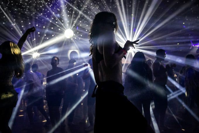 Music fans twist and twirl to EDM music inside the Yuma Tent during Day 3 of the Coachella Valley Music and Arts Festival in Indio, Calif., on April 12, 2015. (Photo by Marcus Yam/Los Angeles Times)