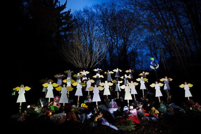 On December 14th 2012, a gunman named Adam Lanza walked into the Sandy Hook elementary school in Newtown, Connecticut, fatally shot 20 children, 6 adult staff members and wounded 2 more before committing suicide by shooting himself in the head. It was later reported that he had killed his own mother, Nancy Lanza, before making his way to the school. In the days to follow, the world started paying attention to this sleepy, cozy Connecticut town. Community members started making makeshift memorials, organize candlelight vigils and church services to mourn those perished in the violent massacre. Even President Barack Obama visited to pay his respects and mourn. The tragedy started a national conversation about gun violence and gun control. It is the second-deadliest school shooting in the United States history since the 2007 Virginia Tech massacre. And in the days to come, twenty something funerals occurring one after another, or even simultaneously as the community buries its loved ones. (Photo by Marcus Yam)