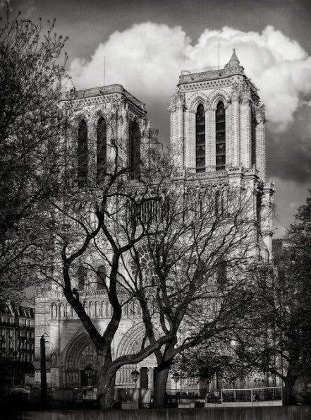 Notre Dame. This was shot with the Canon Power Shot A70 and heavily worked in photoshop to correct perspective and monochrome convert.