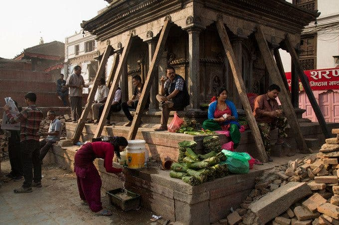 People in the Durbar Square area in Kathmandu, a month after a 7.9 magnitude earthquake struck Nepal. Photo by Oscar Durand