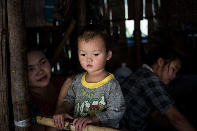 A young family in their single room house in the displacement village of Mae Sam Laeb, Mae Hong Son province.