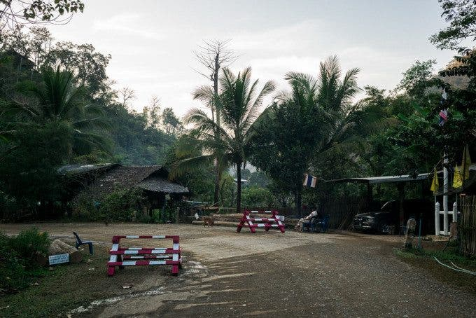 This checkpoint is set up on the road out of the displacement village of Mae Sam Laeb to ensure that only those with the appropriate permit leave the village. Although the checkpoint exists, not every vehicle leaving the village is checked and the road is still quite open, which provides an opportunity for traffickers to take children out without being intercepted.