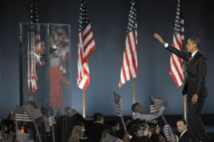 President Elect Barack Obama waves to a crowd of 250,000 through bullet proof glass after becoming the 44th U.S. President on election night in Grant Park in Chicago, Illinois on November 4, 2008.