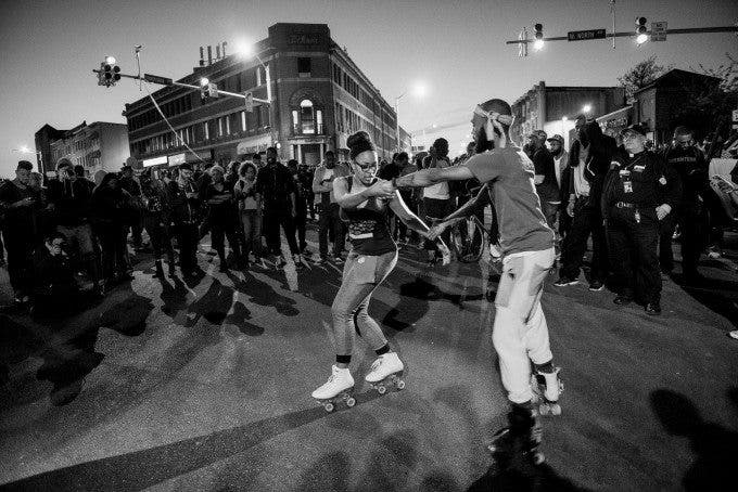 Protestors roller skate in the street the day after rioting and looting over the death of 25 year old Freddie Grey in Baltimore MD on April 28, 2015. (Andrew Renneisen)