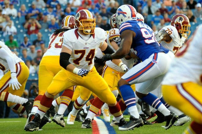 Washington Redskins offensive tackle TYLER POLUMBUS (74) looks to block Buffalo Bills defensive end MARIO WILLIAMS (94) in the first quarter as the Washington Redskins lead the Buffalo Bills 7-3 at the half during the first preseason game at Ralph Wilson Stadium in Orchard Park, New York.