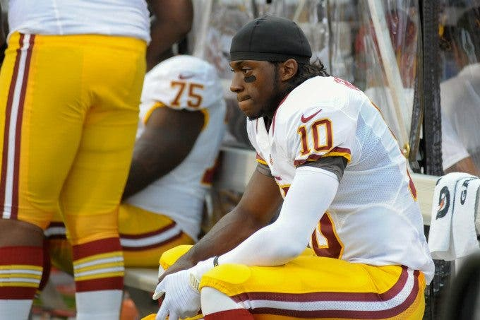 Washington Redskins quarterback ROBERT GRIFFIN III (10) sits on the bench during the first quarter as the Washington Redskins lead the Buffalo Bills 7-3 at the half during the first preseason game at Ralph Wilson Stadium in Orchard Park, New York.