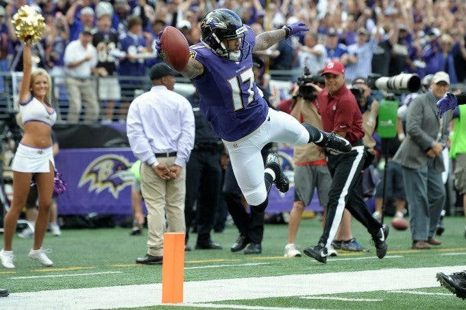 Baltimore Ravens wide receiver TANDON DOSS (17) leaps over the goal line for the touchdown off the punt return late in the second quarter against the Houston Texans at M&T Stadium in Baltimore, Maryland. Baltimore leads Houston 17-9 at the half.