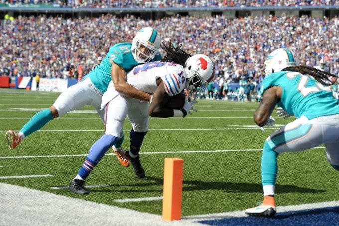 Miami Dolphins cornerback BRENT GRIMES (21) tries to drag Buffalo Bills wide receiver SAMMY WATKINS (14) out of bounds before Watkins scores the third quarter touchdown at Ralph Wilson Stadium in Orchard Park, NY.at Ralph Wilson Stadium in Orchard Park, NY. Buffalo defeated Miami 29-10.