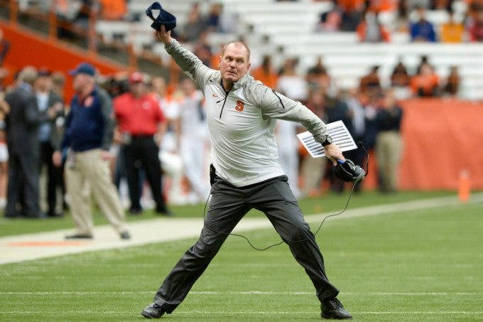 Syracuse Orange head coach SCOTT SHAFER throws his hat in anger following a penalty against his team in the fourth quarter as they battled the Florida State Seminoles at the Carrier Dome in Syracuse, NY. Florida State defeated Syracuse 38-20.
