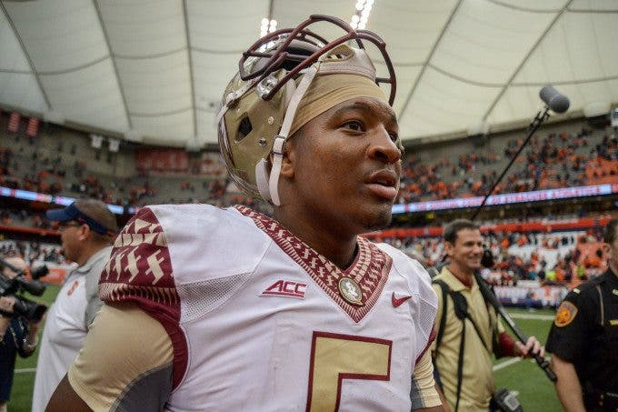 Florida State Seminoles quarterback JAMEIS WINSTON (5) walks off the field following the win over the Syracuse Orange at the Carrier Dome in Syracuse, NY. Florida State defeated Syracuse 38-20.