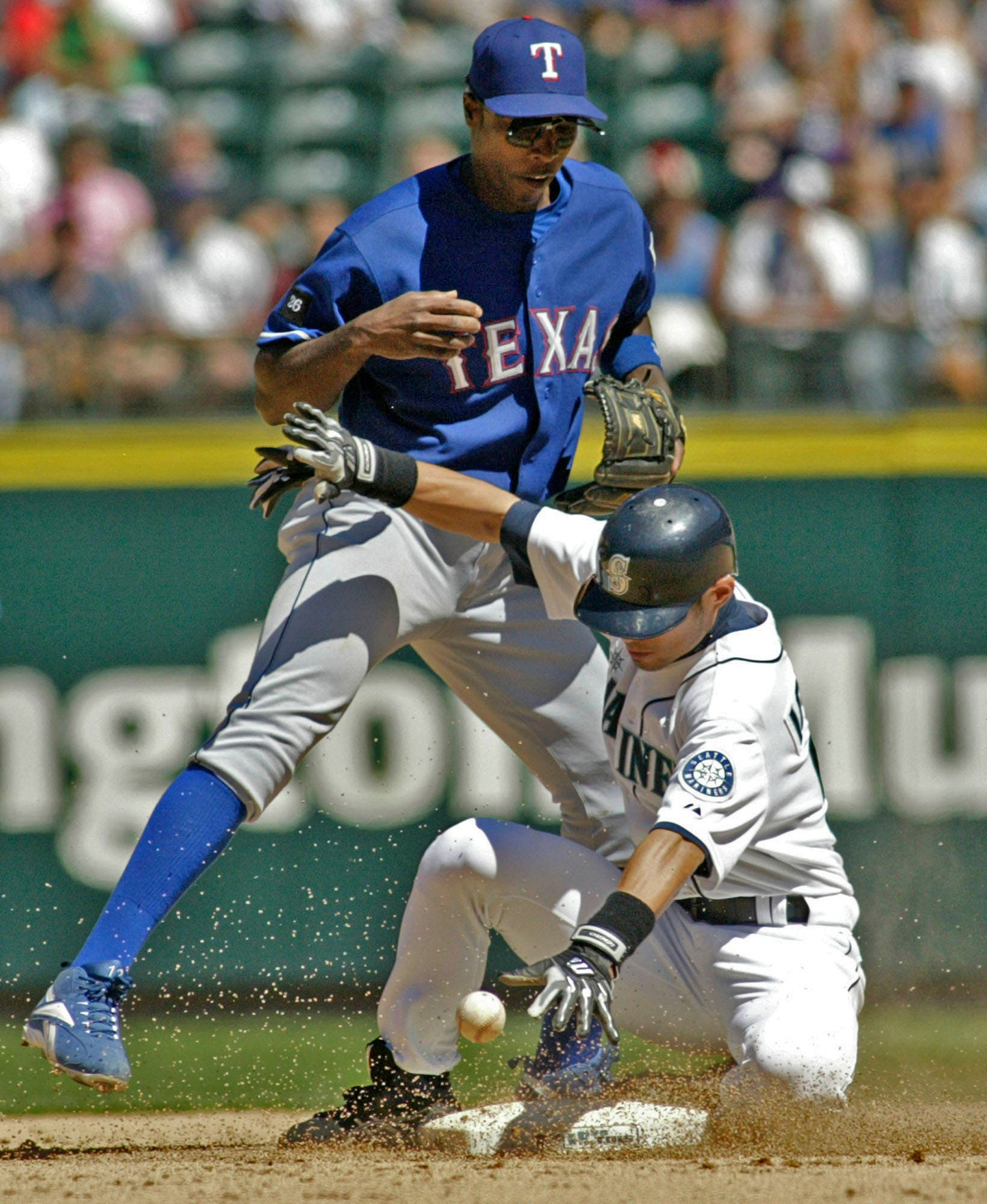 Seattle Mariners Ichiro Suzuki breaks up a double play by forcing Texas Rangers second baseman Alfonso Soriano to drop the ball in the eight inning of their major league game at Safeco Field Sunday, July 3, 2005 in Seattle. Mariners Willie Bloomquist scored on the play as the Mariners beat the Rangers 2-1. ©2005. Jim Bryant Photo. All RIghts Reserved
