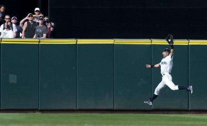 Seattle Mariners fans watch Ichiro Suzuki leap to catch Boston Red Sox J.D. Drew's pop fly to center field in the 11th inning at Safeco Field in Seattle on June 27, 2007. ©2007. Jim Bryant Photo. All RIghts Reserved