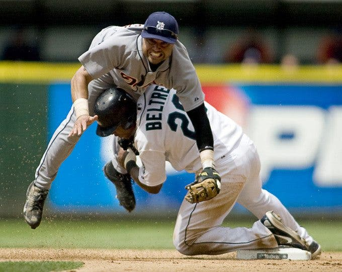 Seattle Mariners' Adrian Beltre, right, breaks up a double play attempt by Detroit Tigers' second baseman Placido Polanco in the seventh inning of Major League Baseball game in Seattle on Sunday, July 6, 2008. ©2008. Jim Bryant Photo. All Rights Reserved