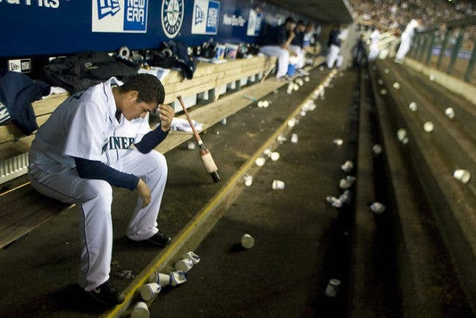 Seattle Mariners starter Felix Hernandez sits alone in the team dugout after being relieved in the eight inning against the Oakland Athletics at Safeco Field in Seattle April 27, 2008. Hernandez struck out 10 batters in the Mariners 2-4 loss to the Athletics. Jim Bryant Photo. ©2008. All Rights Reserved.