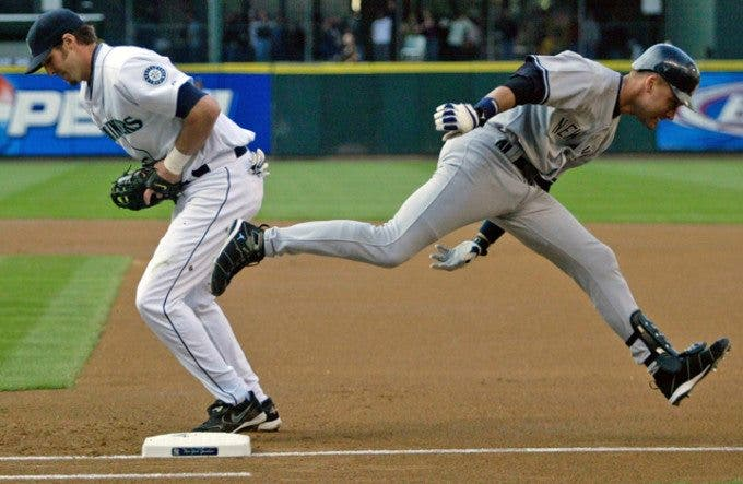 New York Yankees' Derek Jeter (R) runs by Seattle Marines' first baseman Richie Sexton in the first inning of their American league game at Safeco Field in Seattle, Washington on Tuesday, 17 May 2005. Jeter was thrown out by Mariner shortstop Wilson Valdez. ©Jim Bryant Photo. All RIghts Reserved. .