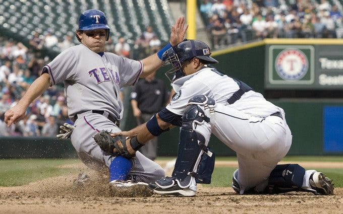 Texas Rangers' Ian Kinsler is tagged out after trying to score from third by Seattle Mariners catcher Guillermo Quiroz in the sixth inning at SAFECO Field in Seattle on September 19, 2010. Kinsler was trying to score when Matt Treanor grounded into fielder's choice to third. The Mariners beat the Rangers 2-1. ©2010. Jim Bryant Photo. All RIghts Reserved.