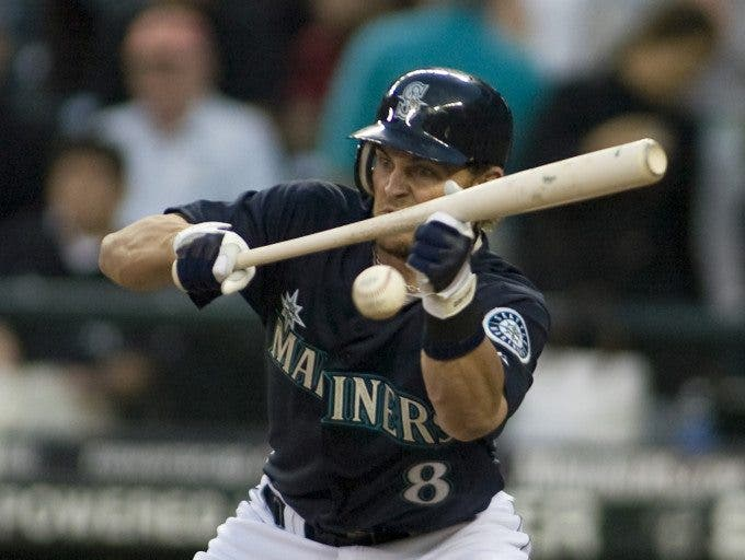 Seattle Mariners' Jeremy Reed lays down a bunt in the seventh inning against the Boston Red Sox at Safeco Field in Seattle May 26, 2008. The Red Sox beat the Mariners 5-3. ©Jim Bryant Photo. All RIghts Reserved.