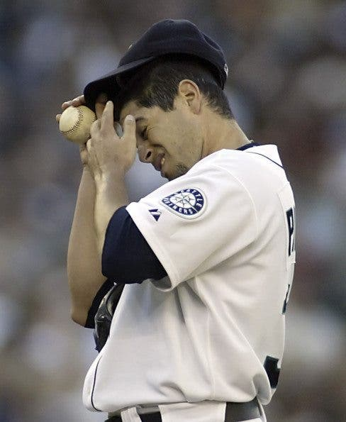 Seattle Mariners starting pitcher Joel Pineiro wipes his brow after Colorado Rockies' Yorvit Torrealba hit a two-run home to right field in the second inning on Saturday, July 1, 2006 in Seattle. ©2006. Jim Bryant Photo. All Rights Reserved
