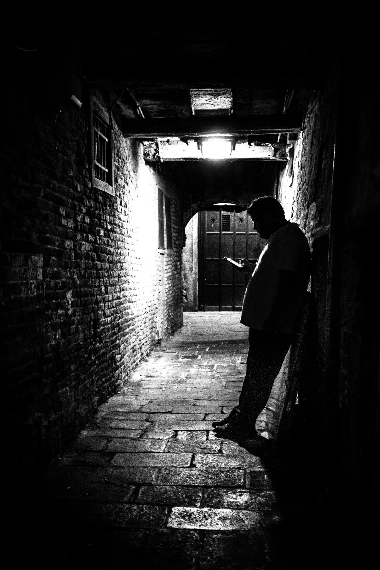 Texting - Venice, Italy - Black and white street photography