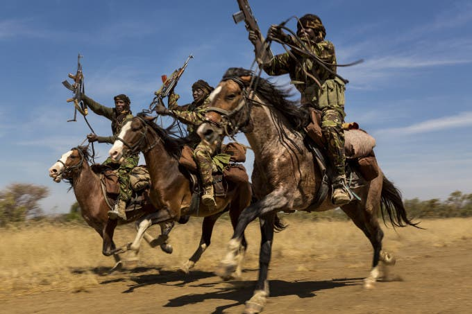 ZAKOUMA NATIONAL PARK, CHAD: Rangers from a horse patrol group exhibit their riding skills as they return to base at Zakouma National Park, Chad after weeks on elephant patrol. The horse patrols are the old guard of Zakouma's rangers and have seen a good deal of conflict in their time in the park. Zakouma lost nearly 75% of its elephants in the decade before 2011 due to raids by Janajaweed and Sudanese poachers, many of them from the Sudanese military. The president of Chad, Idris Deby, is a big supporter of the elephant of Zakouma and of its elephants. The herds here until recently used to be as large as 1000 animals all moving together, severe poaching over the last decade saw that number decimated and now only around 10% of the number remains. Since 2011 however there has been control over poaching and only 3 elephant have been poached in the last 2 years. The credit for that lies with these rangers and the new management of the park, including nomad groups who are a vital part of intelligence gathering for Zakouma.