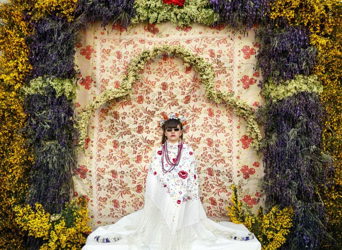 A 'Maya' girl sits in an altar during the traditional celebration of 'Las Mayas' on the streets in Colmenar Viejo, near Madrid, Spain, Friday, May 2, 2014. The festivity of 'Las Mayas' comes from pagan rites and dates from at least the medieval age, appearing in ancient documents. It takes place every year in the beginning of May and celebrates the arrival of the spring. A girl between 7 and 11years is chosen as 'Maya' and should sit still, serious, and quiet for a couple of hours in an altar on the street decorated with flowers and plants, afterwards they walk to the church with their family where they attend a ceremony. Not more than four, or five girls are chosen as a Maya each year.