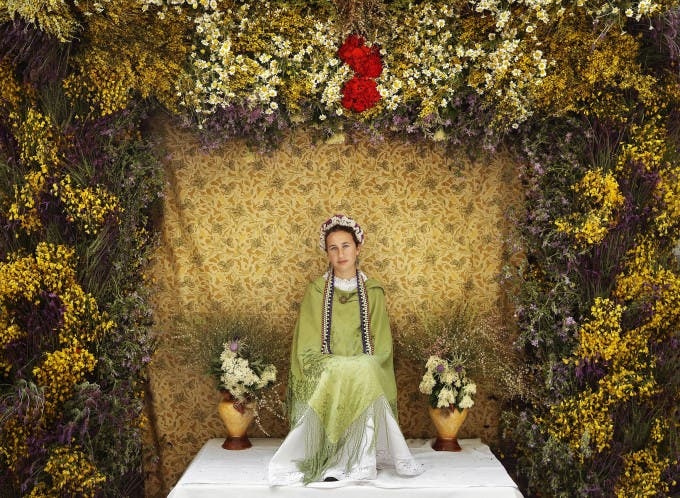 A 'Maya' girl sits on an altar during the traditional celebration of 'Las Mayas' on a street in Madrid, Spain, on Sunday, May 11, 2014. The festivity of 'Las Mayas' comes from pagan rites and dates from at least the medieval age, appearing in ancient documents. It takes place every year in the beginning of May and celebrates the arrival of the spring. A girl between 7 and 11years is chosen as 'Maya' and should sit still, serious, and quiet for a couple of hours in an altar on the street decorated with flowers and plants, afterwards they walk to the church with their family where they attend a ceremony. Not more than four, or five girls are chosen as a Maya each year.