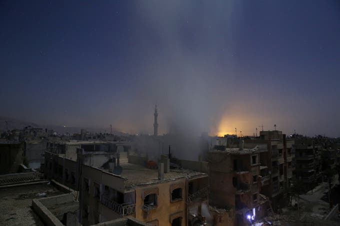 Smoke billows from a building early on October 30, 2015, following reported shelling by Syrian government forces in the rebel-controlled area of Douma, east of Damascus. AFP PHOTO / SAMEER AL-DOUMY
