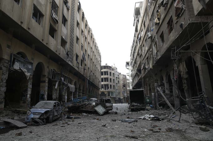 A view of the Syrian town of Douma in the eastern Ghouta region, a rebel stronghold east of the capital Damascus, following air strikes on December 13, 2015. At least 28 civilians were killed in heavy bombardment of the besieged Syrian rebel stronghold, including near a school, according to the Syrian Observatory for Human Rights. AFP PHOTO / SAMEER AL-DOUMY