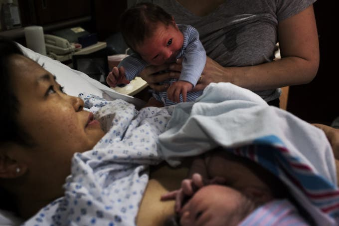 """Emily held Reid up to meet his new little brother. Reid and Eddie were born only four days apart, despite being due three weeks apart. Both babies had the same donor, making them biological half-brothers. """"Oh my God,"""" Kate said, """"we're…like…a family suddenly!"""""""