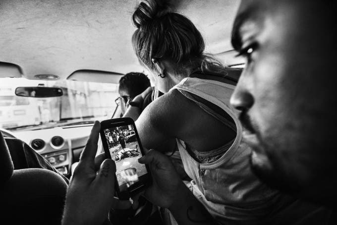 February 2015 - Rio de Janeiro, Brazil: Raul, the leader of Papo Reto collective, just receive an image of the mototaxi driver Diego da Costa Algavez (22), who was shoot to died by a cop in a near favela. They received a message at the collective WhatsApp and inmeditely their shared on their social media, including Facebook, Instragram and Facebook, to alert the local population and be aware that it will be dangerous to walk around that area and also the keep the community well informed. Inmediately they change their path and go straight to the place where a driver died.
